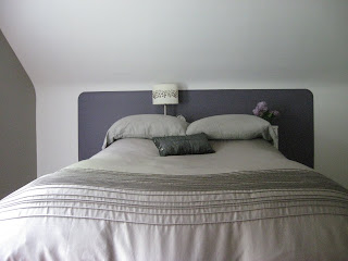 image of purple painted rectangle with rounded corners behind headboard