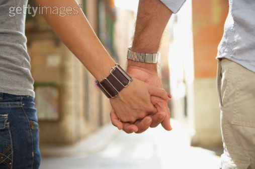 Both Couples Holding Hands