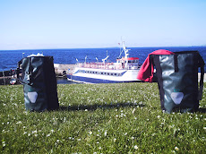Panniers at John O Groats -an homage to the gnome in 'Amelie'