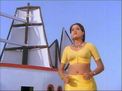 http://3.bp.blogspot.com/_-QzUdVMcE94/SyYbG-fXAYI/AAAAAAAADq8/qoHWU9gmvts/s400/vijayashanti+in+yellow+saree.jpg