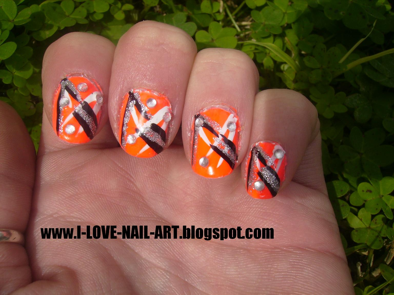 Orange and Black Nail Designs http://i-love-nail-art.blogspot.com/2010/09/neon-orange-abstract.html