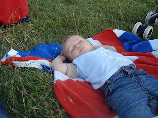 Baby Boy asleep on a Union Jack Picnic Mat