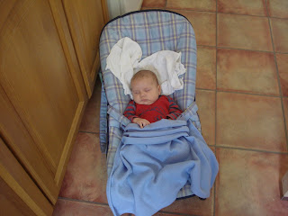 Baby Boy asleep in his Bouncy Chair in the Kitchen