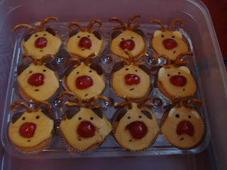 Cupcakes iced and decorated to look like Rudolph the red nosed Reindeer