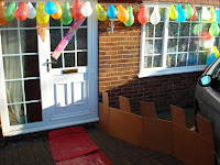 Red Carpet leading to the Front door with Home Made Battlements