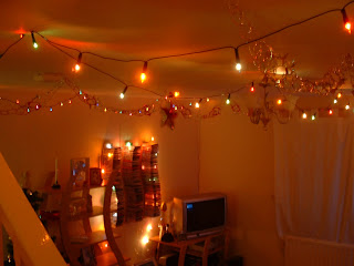 Christmas lights in the living room with the light off