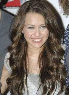 Teen sensation Miley Cyrus is determined to be the next Madonna, ...