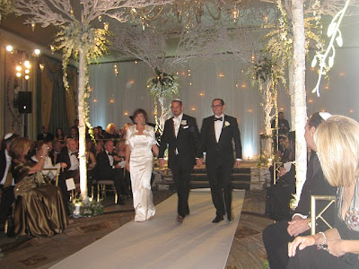 white and the chuppah looked snow had just fallen onto a canopy of trees