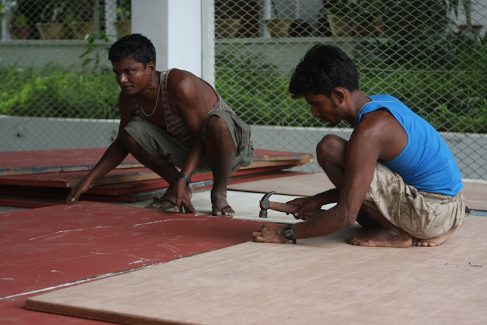 Rangoon, Burma:  Creating a stage on a basketball court