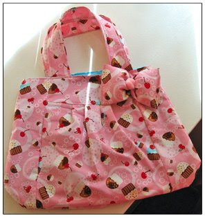 Pink bag with cupcakes on
