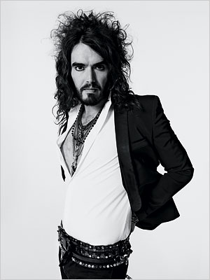 ... excessive jewellery and skinny jeans are Russel Brand's signiture style.