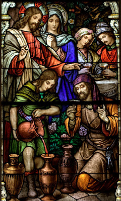 Stained glass window of Jesus turning water into wine