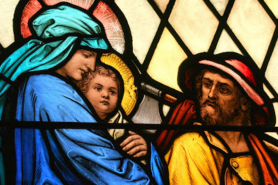 Close up of stained glass window with Mary, Joseph, Jesus fleeing to Egypt