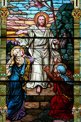 Stained Glass window with the resurected Christ greeting Mary Magdelay and Mary mother of James outside the tomb.