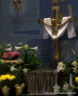 Modern Crucifix with white sash and Easter flowers