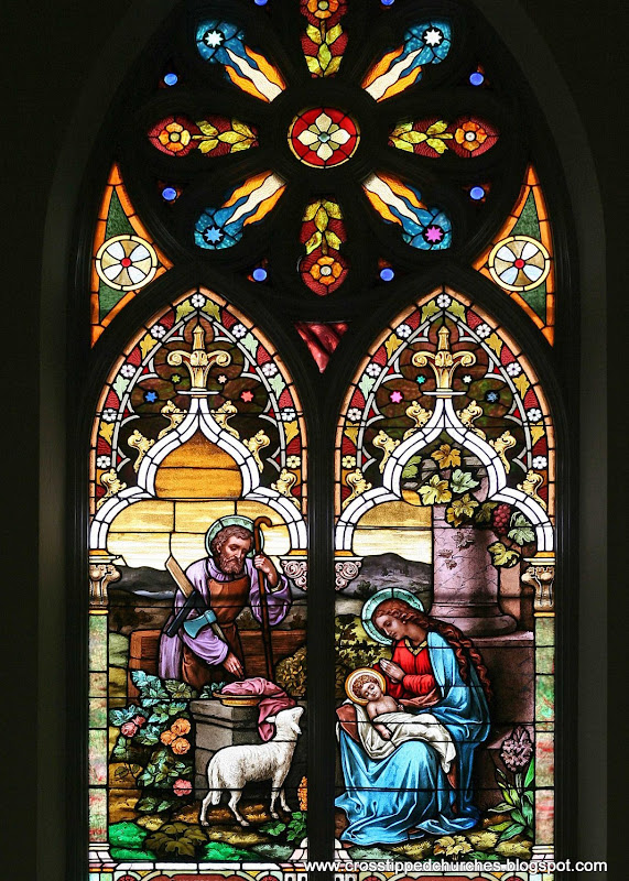 Large stained glass window of the Holy Family, Joseph, Mary and the infant Jesus