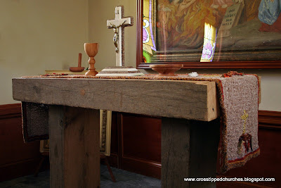 Rustic old wooden beam Alter with Crucifix and elements of the Eucharist.