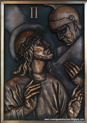 Bronze relief of Jesus taking up his cross.