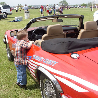 child boy red racecar convertible