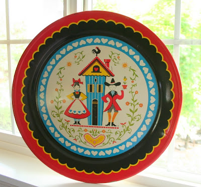 modish vintage pennsylvania dutch tin platter