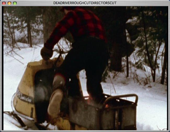[w+gets+on+fiery+snowmobile.jpg]