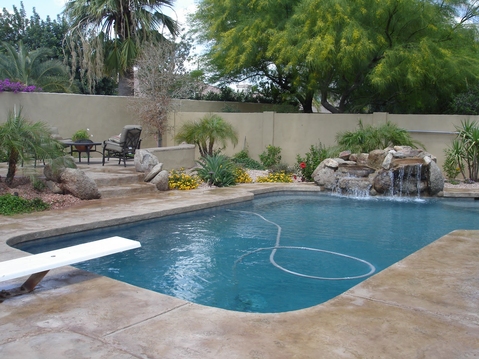 Empire concrete designs new pool deck and raised patio for Outside pool designs