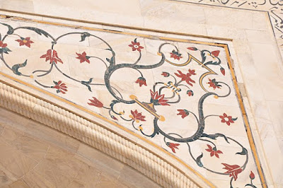 Floral motifs inlaid with stone above the south portal