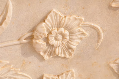 Flower cut in marble, south portal
