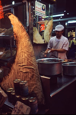 A whale shark fin on display outside of a shark fin restaurant, with shark fin soup preparation in the background. Bangkok, Thailand. Photo by Rob Stewart