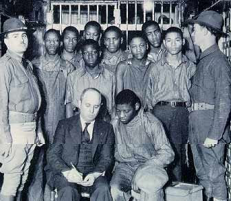 Scottsboro Boys with their lawyer in jail