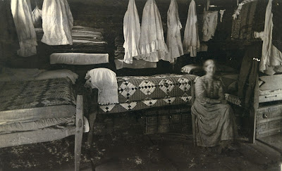 Kentucky woman with quilts, late 19th century