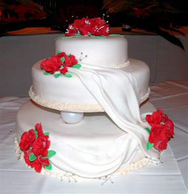 3 Tier Wedding Cake Top layer covered in fantasy flowers