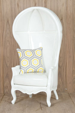 glossy white patent faux leather upholstery and glossy white lacquer carved frame