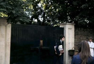 Paul McCartney carrying an accordion