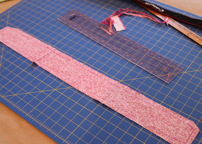 Scrap Ribbon Camera Strap Cover (A Tutorial) step 7 via lilblueboo.com