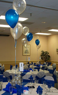 Party people event decorating company royal blue and silver wedding the top of this 3 balloon cluster were anchored inside the brides vases filled with mini silver balloons under the vase we placed blue organza and mini junglespirit Images