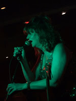 Gina Birch on-stage at Barden's Boudoir; photo by Val Phoenix