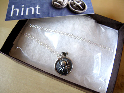 silver spider charm necklace package