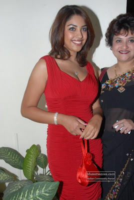 Richa Gangopadhyay looking hot in red short outfit
