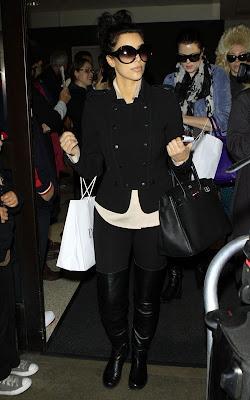 Kim and Khloe Kardashian Arriving on a flight at LAX Airport Pics