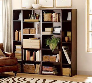 W design studios bookscases shelves and things to put things on for Things to put on shelves in living room
