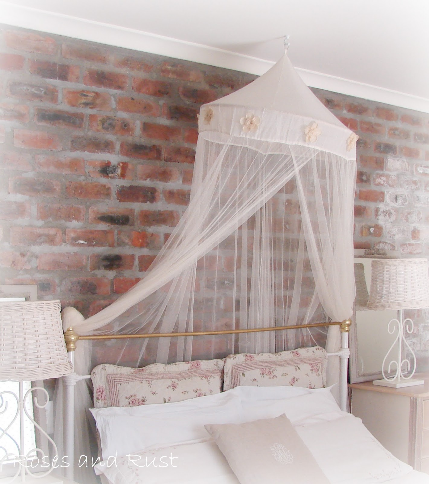 Roses and rust exposed brick in the bedroom for Black brick wallpaper bedroom