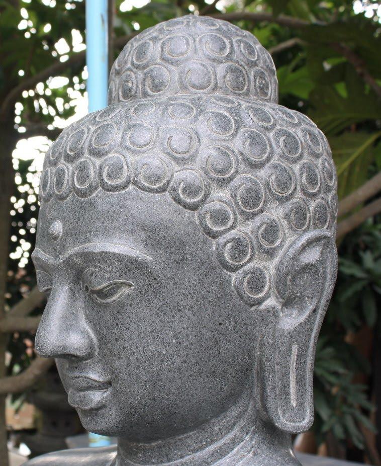 Ancient stone buddha sculpture