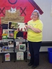 Mrs. Van holding the book Tillie Lays An Egg