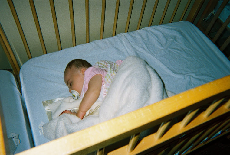 Lilly sleeping in her crib at school