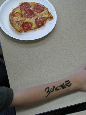 I'm guessing that this arm belongs to Zeke and Yes we ribed them with Pizza