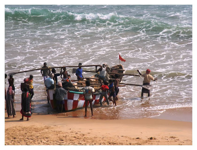 Fishing boats being put out to sea. Gopalpur-on-Sea