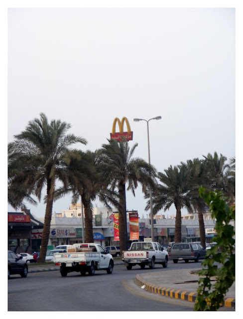 The MacDonald sign towers over the City