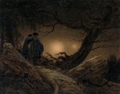 dos hombres mirando la luna