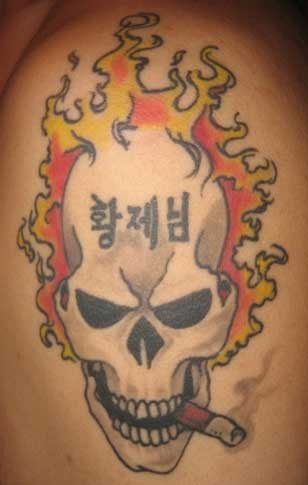 Skull Tattoo Designs Combination With Flame Tattoo And Cigarette Tattoo On